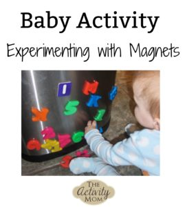 baby activity experimenting with magnets
