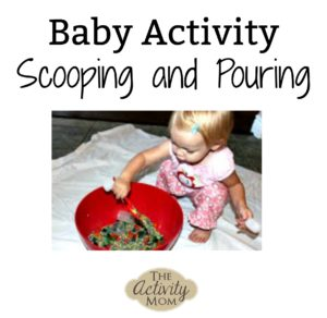 baby activity scooping and pouring